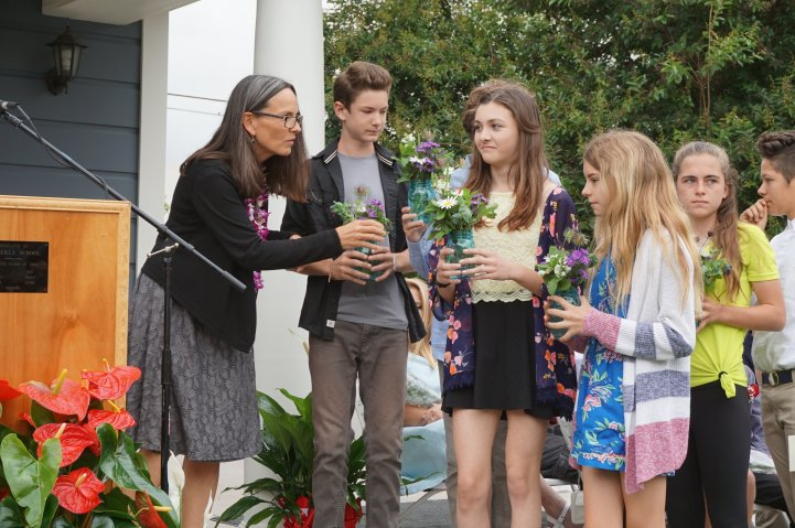 Heidi at middle school graduation with students