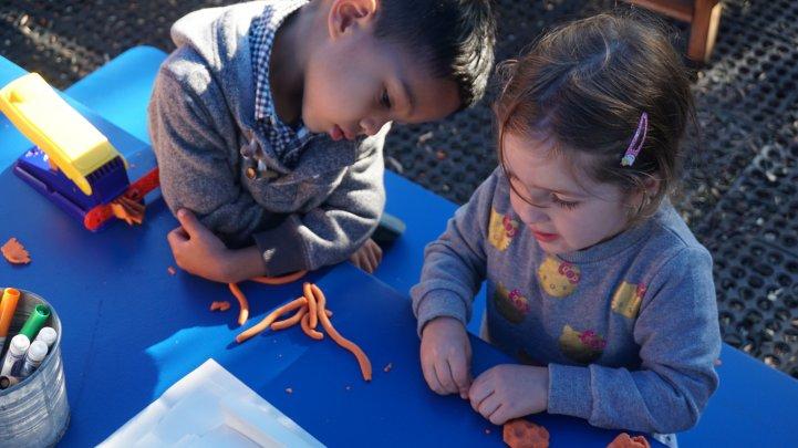 Preschool kids work with clay