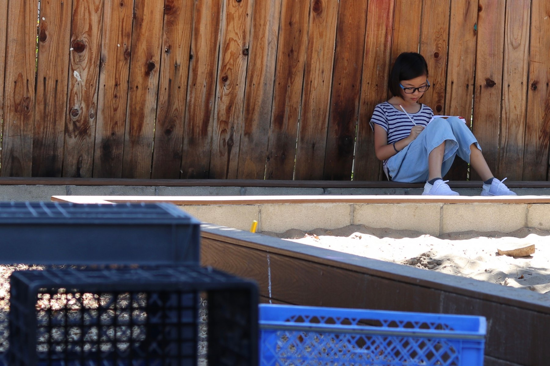 ES girl writing solo play yard