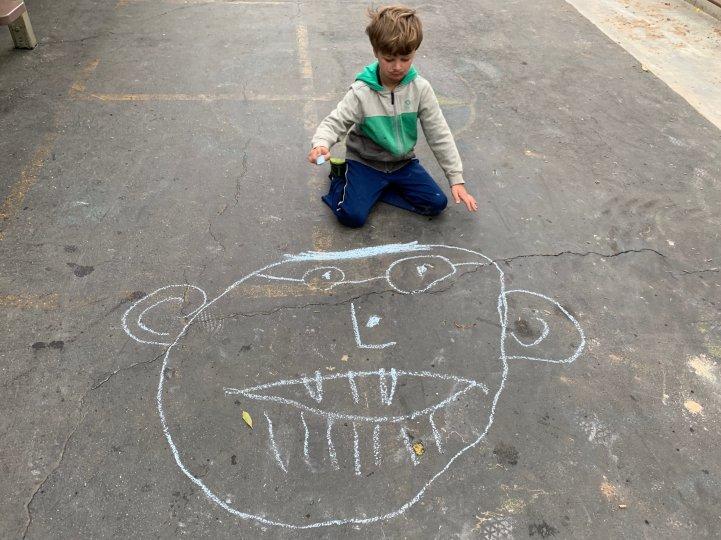 ES Boy play yard chalk drawing
