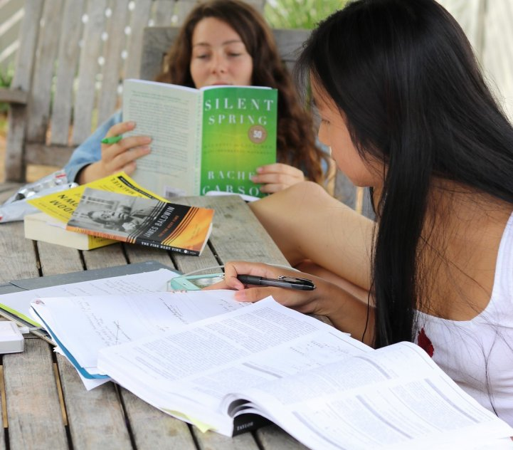 HS Girls read and study outdoors