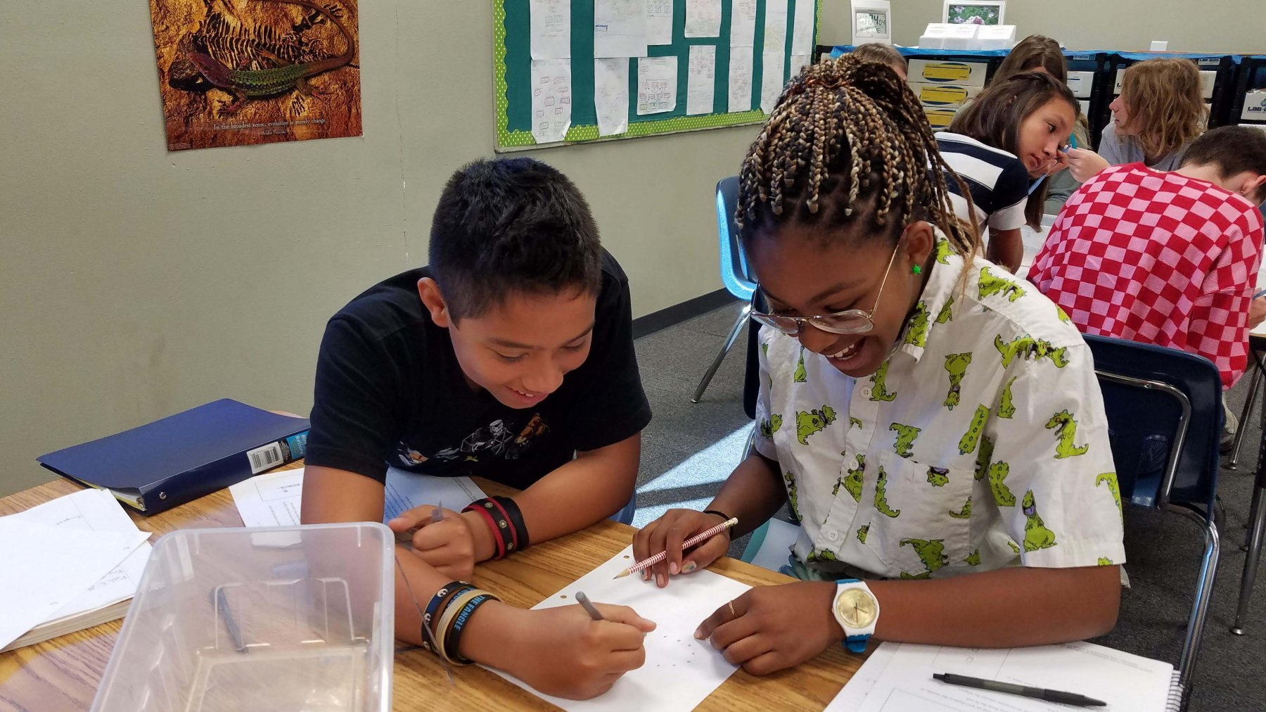 MS Students smile in science classroom lab partners