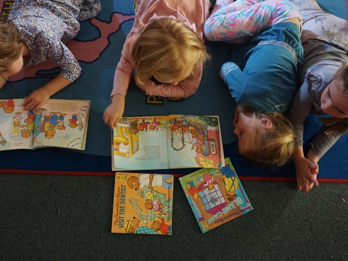 ES girls reading on rug