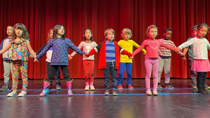 ES Kindergarten on stage holding hands