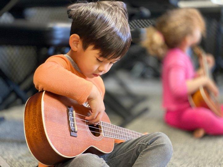 ES boy plays ukulele