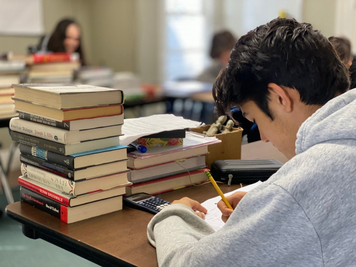HS student classroom stack of books