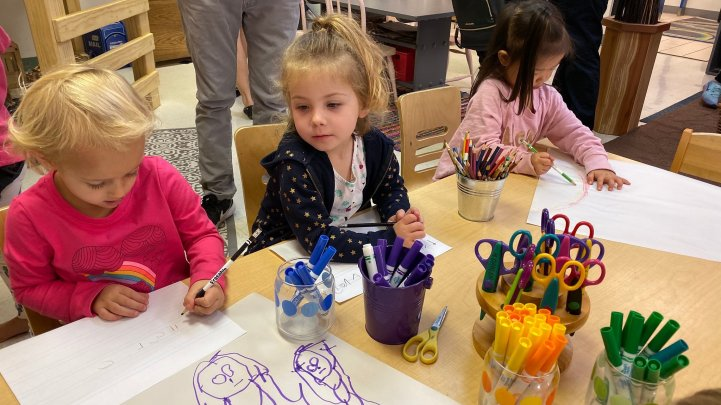 Preschool students write and draw