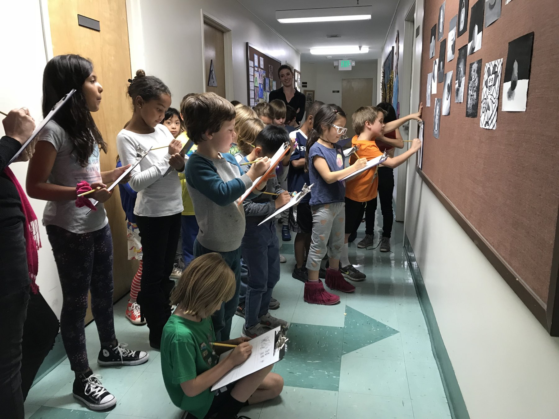 ES Studying art on walls in hallway