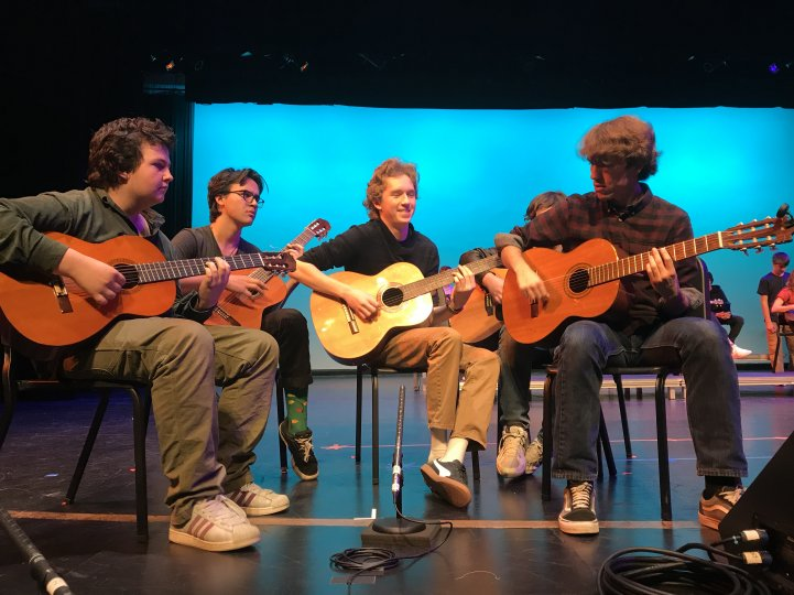 HS Boys play guitar on stage
