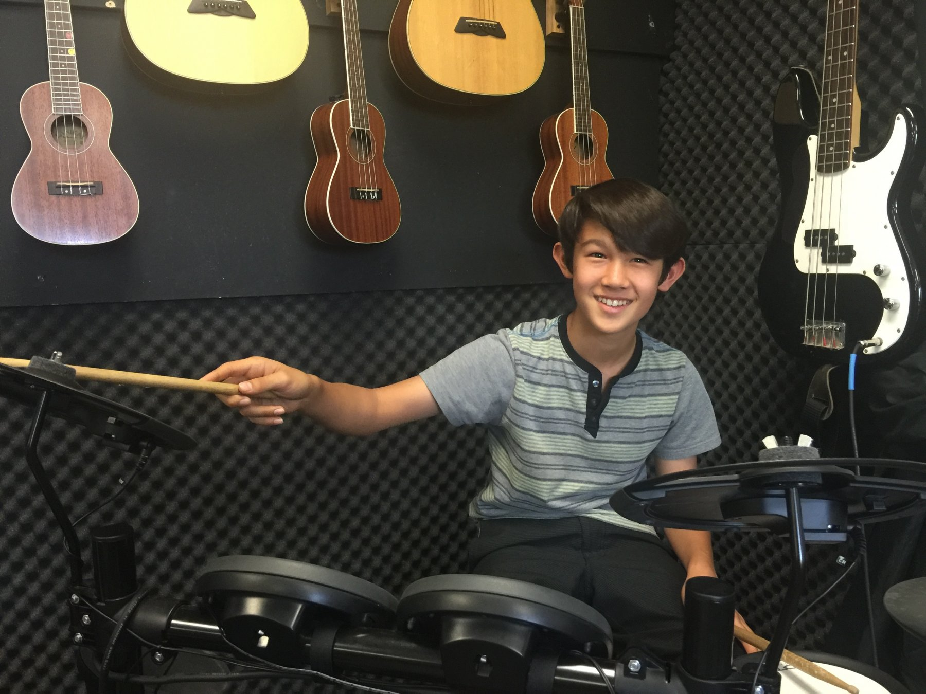 MS Music studio boy playing drums