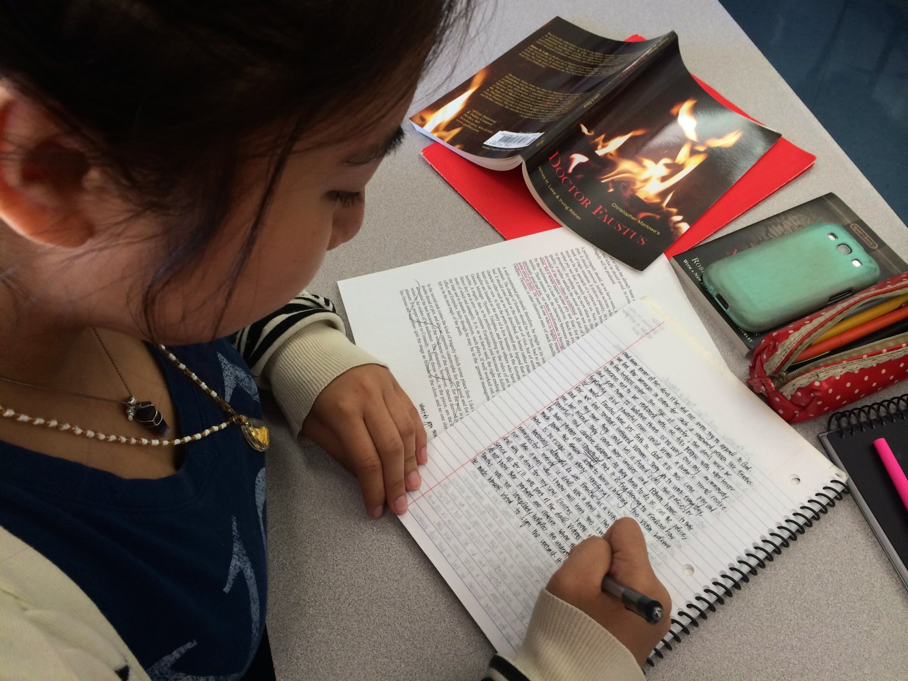 HS Student writing in journal humanities